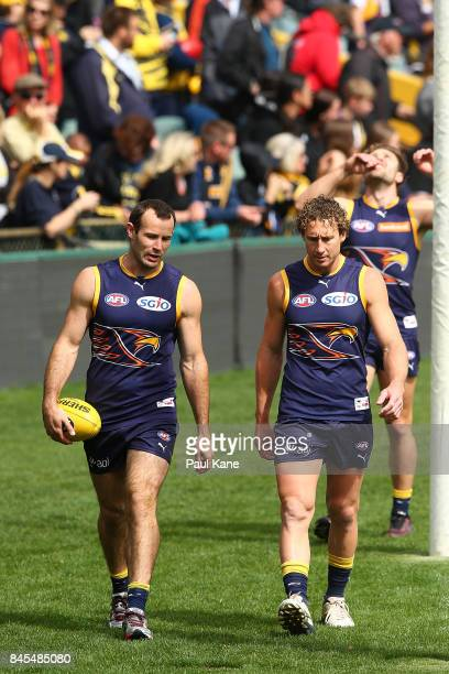 Shannon Hurn and Matt Priddis walk laps during a West Coast Eagles AFL training session at Domain Stadium on September 11 2017 in Perth Australia