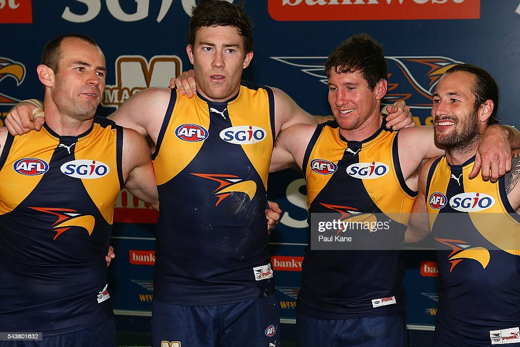 Shannon Hurn, Jeremy McGovern, Patrick McGinnity and Chris Masten of the Eagles celebrate winning the round 15 AFL match between the West Coast Eagles and the Essendon Bombers at Domain Stadium on June 30, 2016 in Perth, Australia.