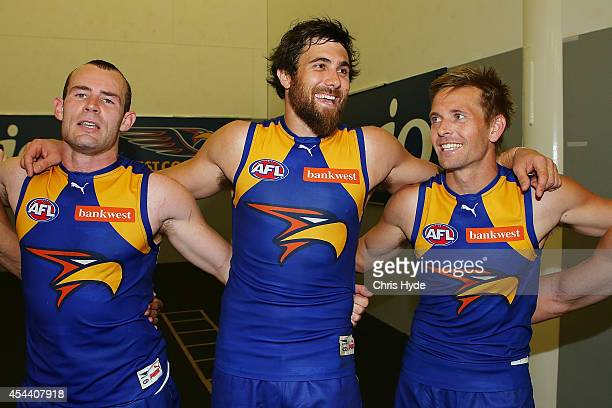 Shannon Hurn Josh Kennedy and Mark LeCras of the Eagles sing the team song after winning the round 23 AFL match between the Gold Coast Suns and the...