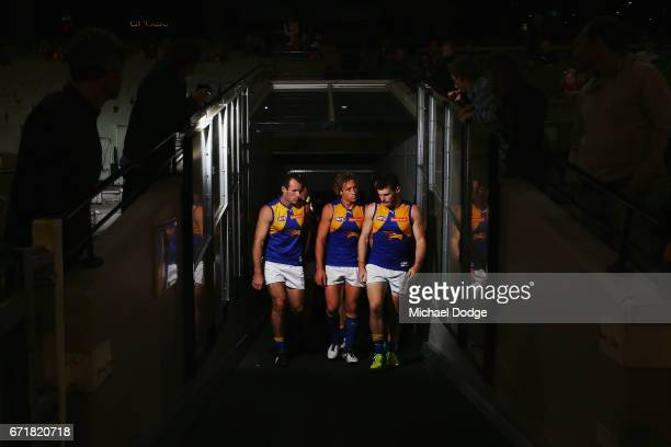 Shannon Hurn Matt Priddis and Luke Shuey of the Eagles lead the team out during the round five AFL match between the Hawthorn Hawks and the West...