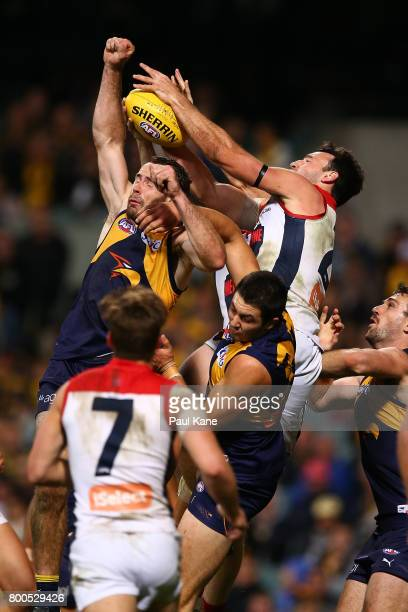 Shannon Hurn of the Eagles and Cameron Pedersen of the Demons contest for a mark during the round 14 AFL match between the West Coast Eagles and the...