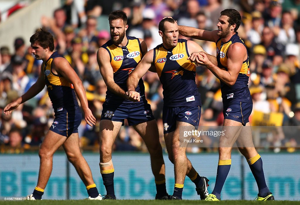 Shannon Hurn of the Eagles celebrates a goal with Mitchell Brown and Jack Darling during the round 16 AFL match between the West Coast Eagles and the North Melbourne Kangaroos at Domain Stadium on July 10, 2016 in Perth, Australia.