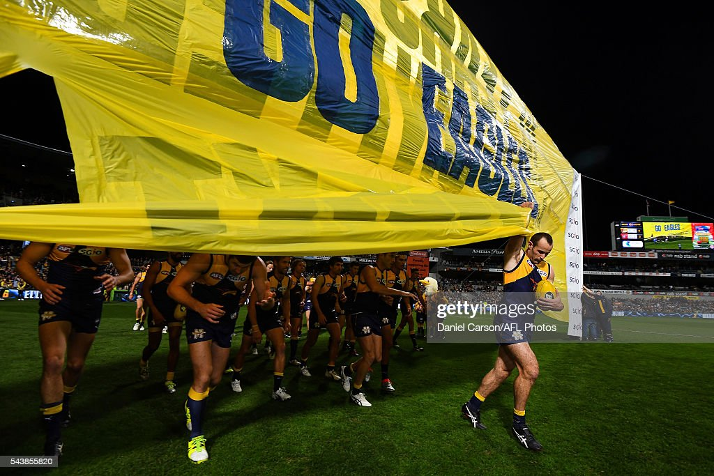 Shannon Hurn of the Eagles leads the team through the banner during the 2016 AFL Round 14 match between the West Coast Eagles and the Essendon Bombers at Domain Stadium on June 30, 2016 in Perth, Australia.