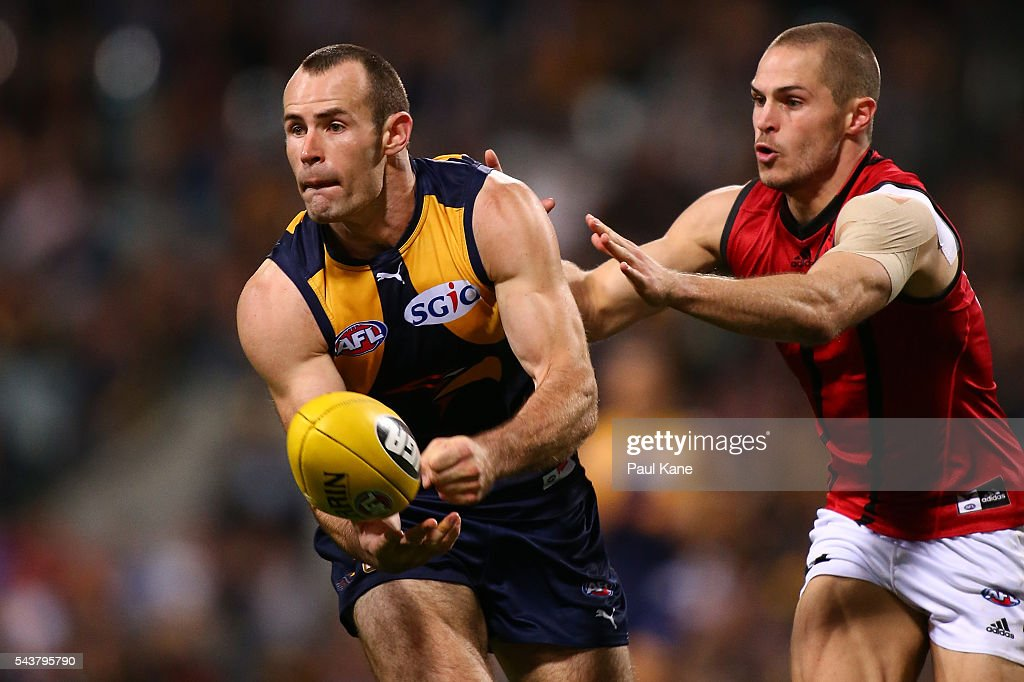 Shannon Hurn of the Eagles looks to handball during the round 15 AFL match between the West Coast Eagles and the Essendon Bombers at Domain Stadium on June 30, 2016 in Perth, Australia.