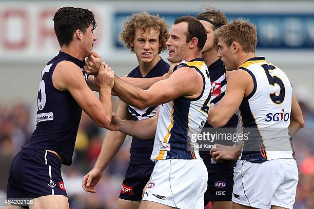 Shannon Hurn of the Eagles wrestles with Alex Pearce of the Dockers before the first bounce during the round 20 AFL match between the Fremantle...