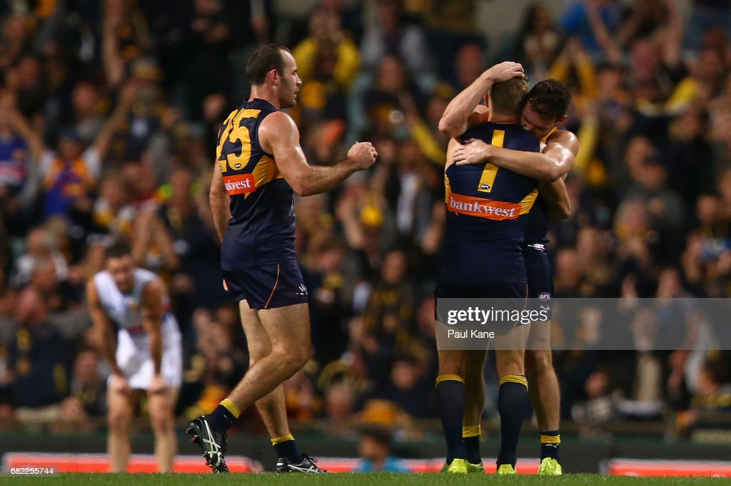 Shannon Hurn, Sam Mitchell and Luke Shuey of the Eagles celebrate winning the round eight AFL match between the West Coast Eagles and the Western Bulldogs at Domain Stadium on May 12, 2017 in Perth, Australia.