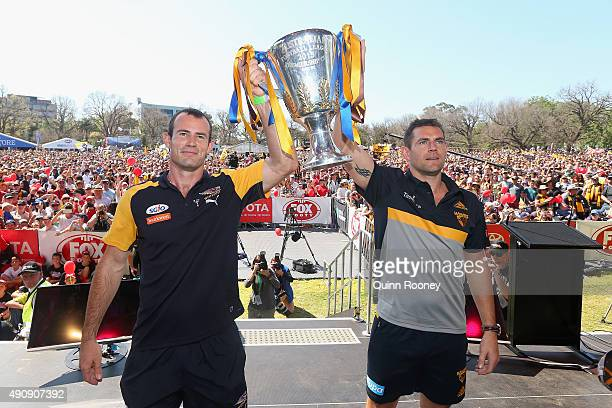 Shannon Hurn the captain of the Eagles and Luke Hodge the captain of the hawks pose with the Premiership trophy during the 2015 AFL Grand Final...