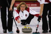 Shannon Kleibrink of Canada releases the stone during the bronze medal match of the women's curling between Norway and Canada during Day 13 of the...