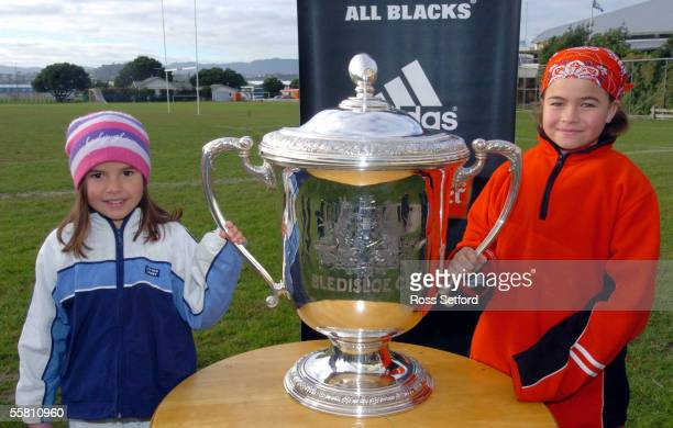 Shannon left and Amanda O'Loughlin get their hands on the Bledisloe Cup at Wiliment Rugby week at the Poneke Rugby Club Wellington New Zealand...