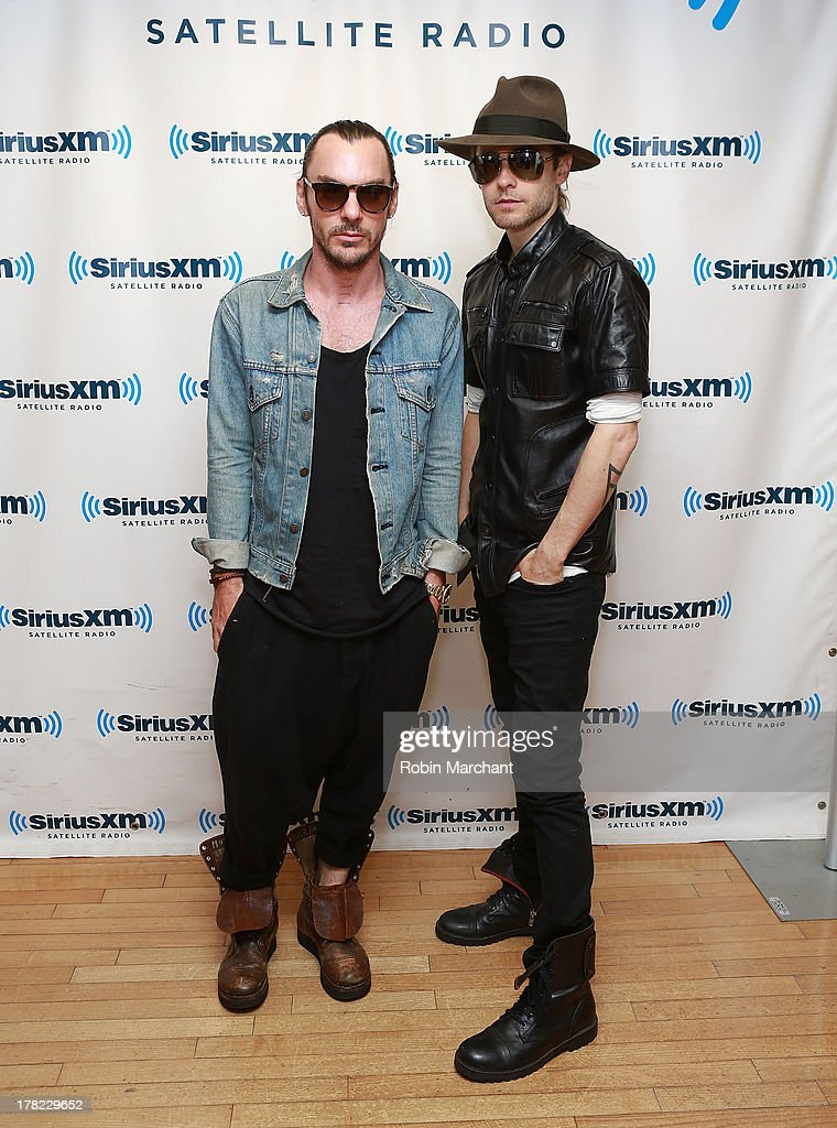 <a gi-track='captionPersonalityLinkClicked' href=/galleries/search?phrase=Shannon+Leto&family=editorial&specificpeople=764946 ng-click='$event.stopPropagation()'>Shannon Leto</a> (L) and <a gi-track='captionPersonalityLinkClicked' href=/galleries/search?phrase=Jared+Leto&family=editorial&specificpeople=214764 ng-click='$event.stopPropagation()'>Jared Leto</a> of Thirty Seconds to Mars visit at SiriusXM Studios on August 27, 2013 in New York City.