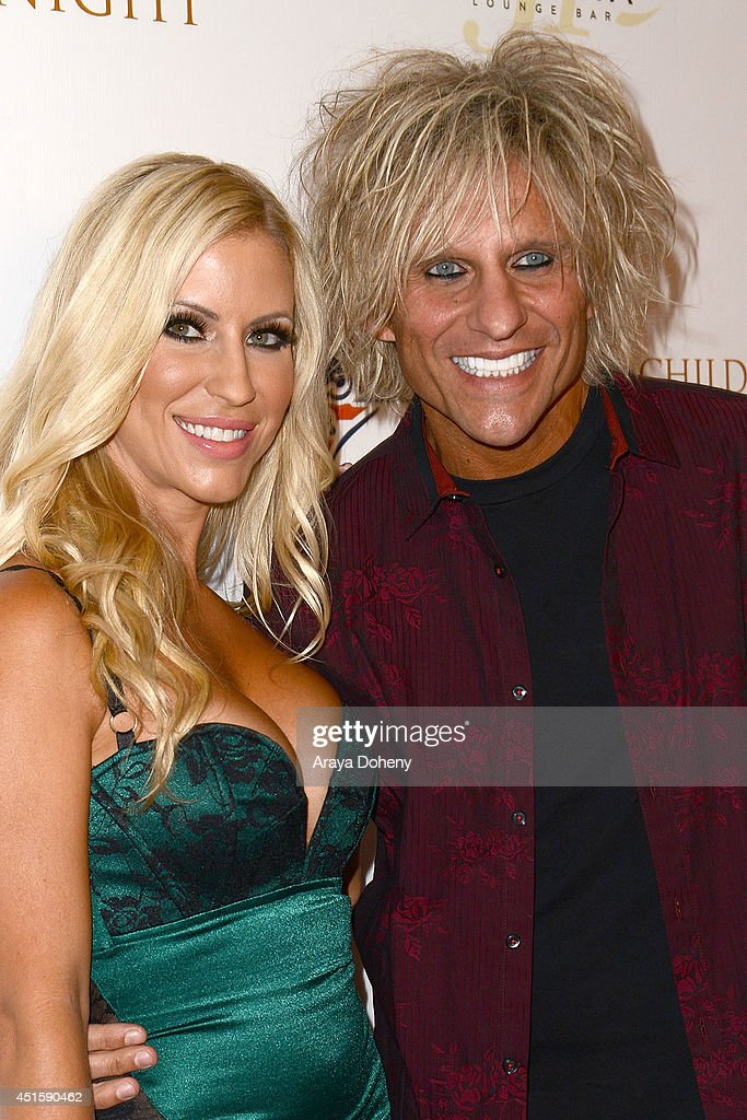 Shannon Malone and <a gi-track='captionPersonalityLinkClicked' href=/galleries/search?phrase=C.C.+DeVille&family=editorial&specificpeople=632358 ng-click='$event.stopPropagation()'>C.C. DeVille</a> attend the Children of The Night and BenchWarmer's annual Stars & Stripes event on July 1, 2014 in Los Angeles, California.