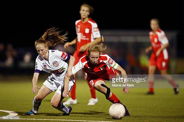 Shannon May of Perth is brought down by Elizabeth Milne of Adelaide during the round eight WLeague match between Adelaide United and Perth Glory at...