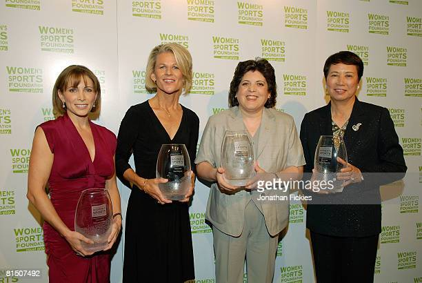 Shannon Miller Sue Enquist Hassiba Boulmerka and Hisako Higuchi pose with their awards prior to be inducted into the International Women's Sports...