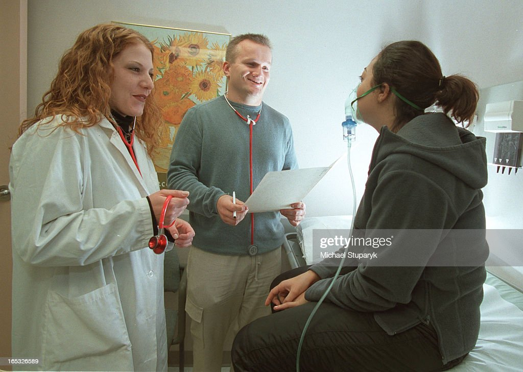 N Shannon Monaco in lab coat with Dr Kevin O'Connorhe didn't know anything about this assignment unfortunately and girl on exam table is receivi8ng...
