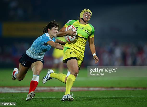 Shannon Parry of Australia is tackled by Nadezda Kudinova of Russia during the Emirates Dubai Rugby Sevens HSBC World Rugby Women's Sevens Series Cup...