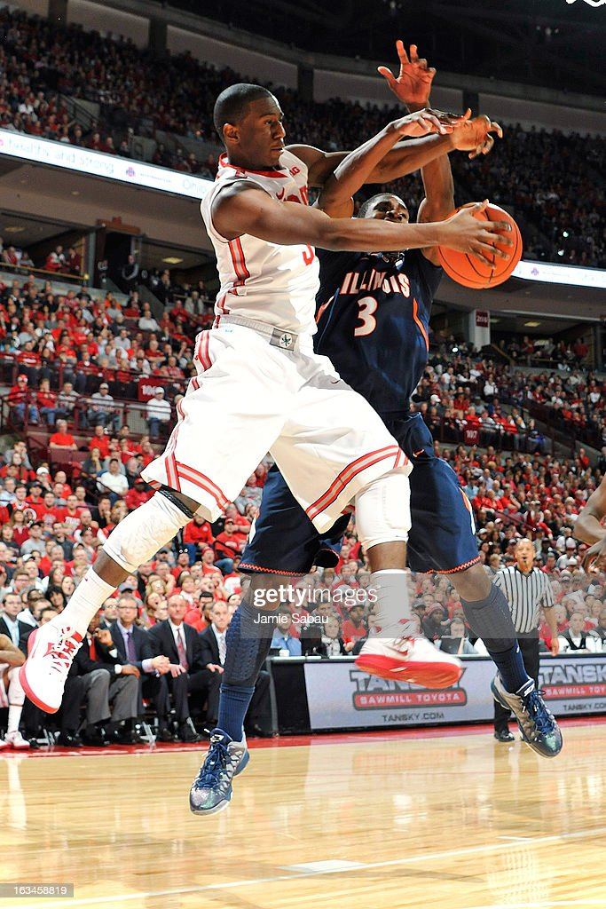 Shannon Scott #3 of the Ohio State Buckeyes and Brandon Paul #3 of the Illinois Fighting Illini battle for control of the ball under the basket in the second half on March 10, 2013 at Value City Arena in Columbus, Ohio. Ohio State defeated Illinois 68-55.