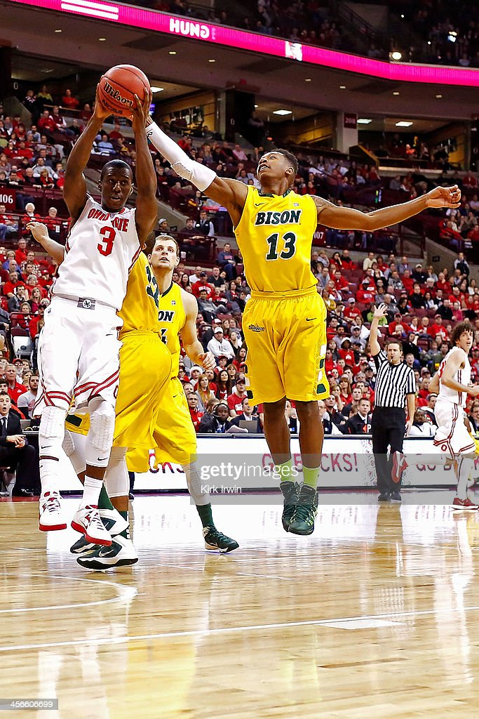Shannon Scott #3 of the Ohio State Buckeyes and Carlin Dupree #13 of the North Dakota State Bison compete for a rebound during the second half at Value City Arena on December 14, 2013 in Columbus, Ohio. Ohio State defeated North Dakota State 79-62.