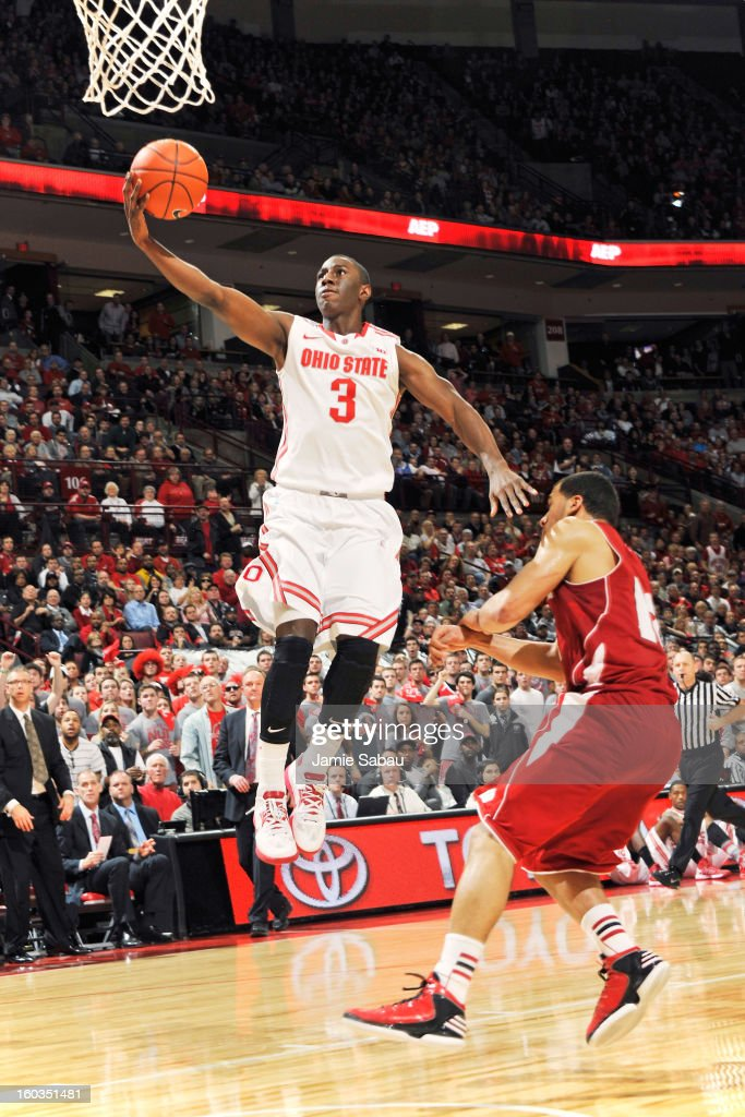 Shannon Scott #3 of the Ohio State Buckeyes completes a fast break off a steal with a layup over Traevon Jackson #12 of the Wisconsin Badgers in the second half on January 29, 2013 at Value City Arena in Columbus, Ohio. Ohio State defeated Wisconsin 58-49.