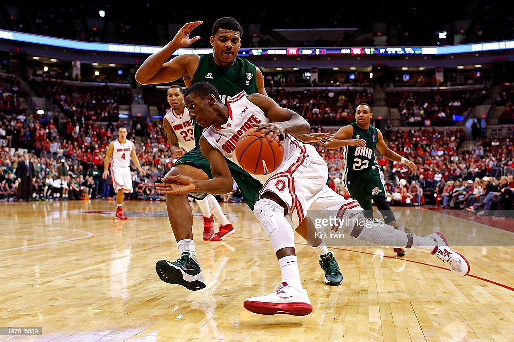 Shannon Scott #3 of the Ohio State Buckeyes drives against Antonio Campbell #3 of the Ohio Bobcats during the second half at Value City Arena on November 12, 2013 in Columbus, Ohio. Ohio State defeated Ohio 79-69.