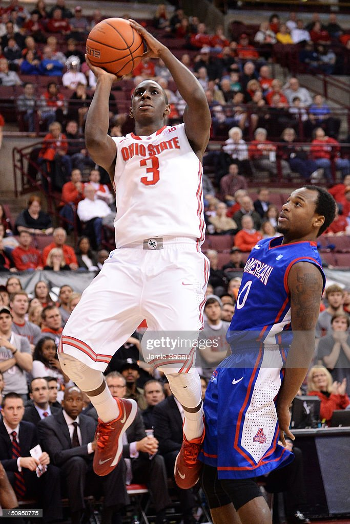 Shannon Scott #3 of the Ohio State Buckeyes drives to the basket for two points in the second half past Darius Gardner #0 of the American University Eagles on November 20, 2013 at Value City Arena in Columbus, Ohio. Ohio State defeated American 63-52.