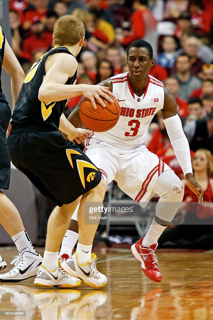 Shannon Scott of the Ohio State Buckeyes guards Mike Gesell of the Iowa Hawkeyes during the game at Value City Arena on December 30 2014 in Columbus...