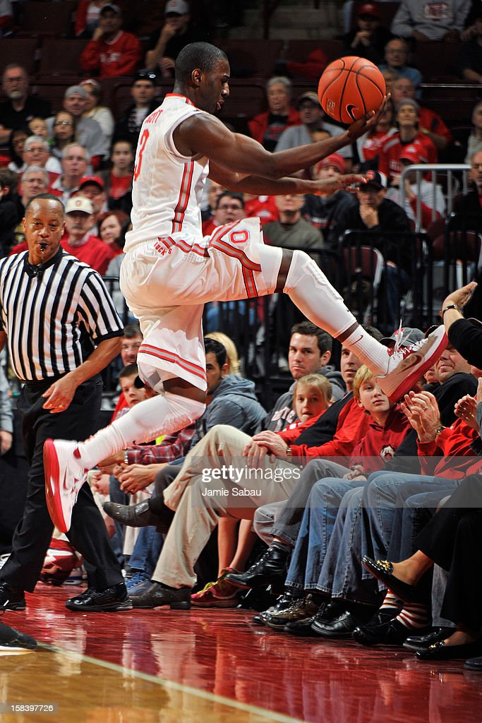 Shannon Scott #3 of the Ohio State Buckeyes leaps in to the crowd as he attempts to save the ball from going out of bounds in the second half against UNC Asheville on December 15, 2012 at Value City Arena in Columbus, Ohio. Scott was unable to save the ball.