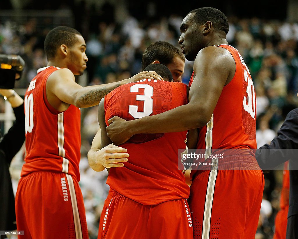 Shannon Scott #3 of the Ohio State Buckeyes reacts after missing a three-point shot at the buzzer with LaQuinton Ross #10 and Evan Ravenel #30 against the Michigan State Spartans at the Jack Breslin Center on January 19, 2013 in East Lansing, Michigan. Michigan State won the game 59-56.
