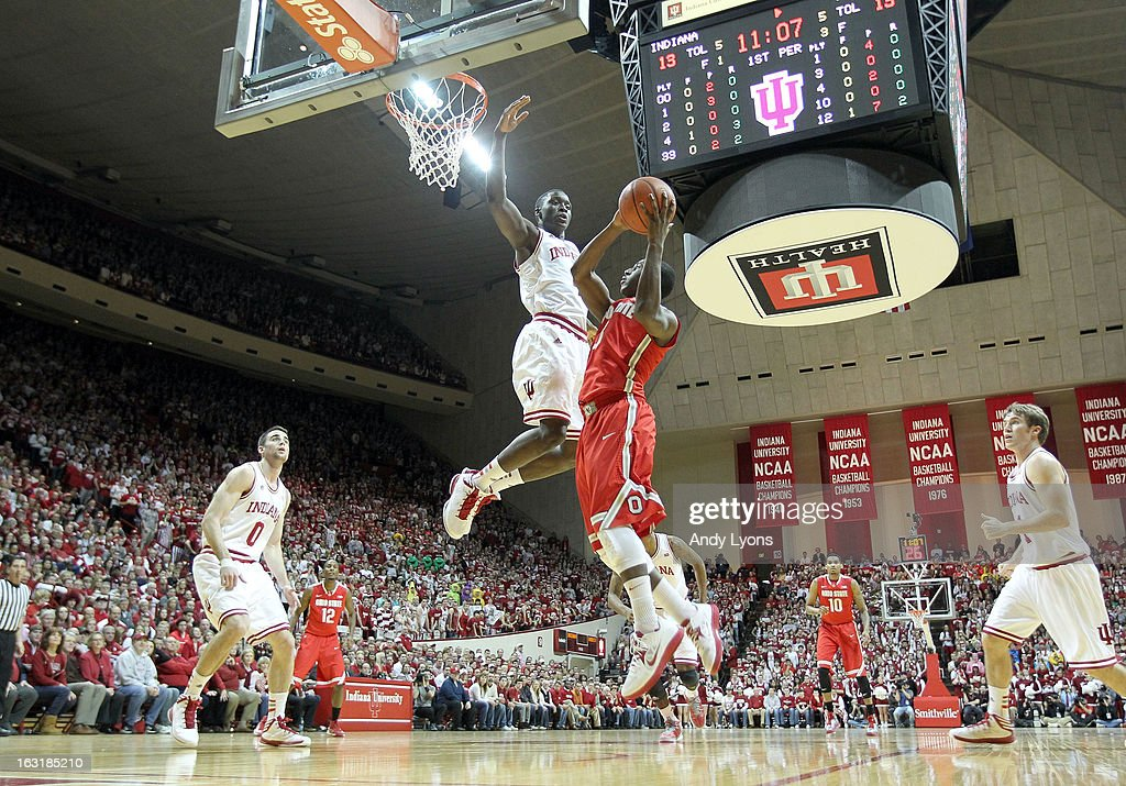 Shannon Scott #3 of the Ohio State Buckeyes shoots the ball while defended by <a gi-track='captionPersonalityLinkClicked' href=/galleries/search?phrase=Victor+Oladipo&family=editorial&specificpeople=6681560 ng-click='$event.stopPropagation()'>Victor Oladipo</a> #4 of the Indiana Hoosiers during the game at Assembly Hall on March 5, 2013 in Bloomington, Indiana. Ohio State won 67-58.