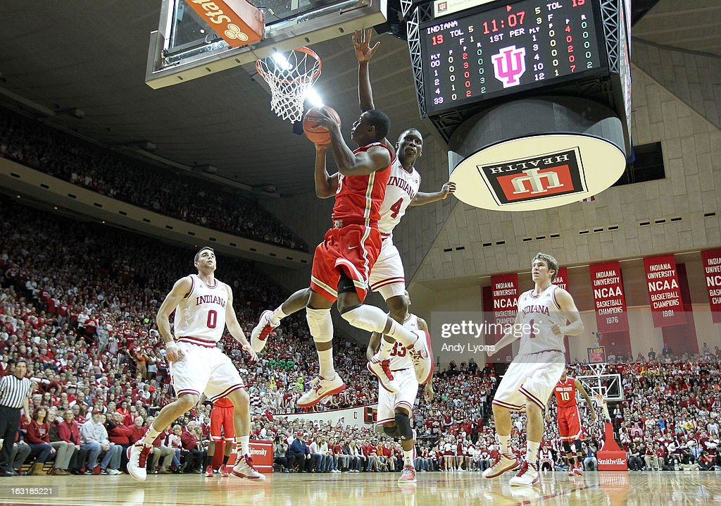 Shannon Scott #3 of the Ohio State Buckeyes shoots the ball while defended by Victor Oladipo #4 of the Indiana Hoosiers during the game at Assembly Hall on March 5, 2013 in Bloomington, Indiana. Ohio State won 67-58.