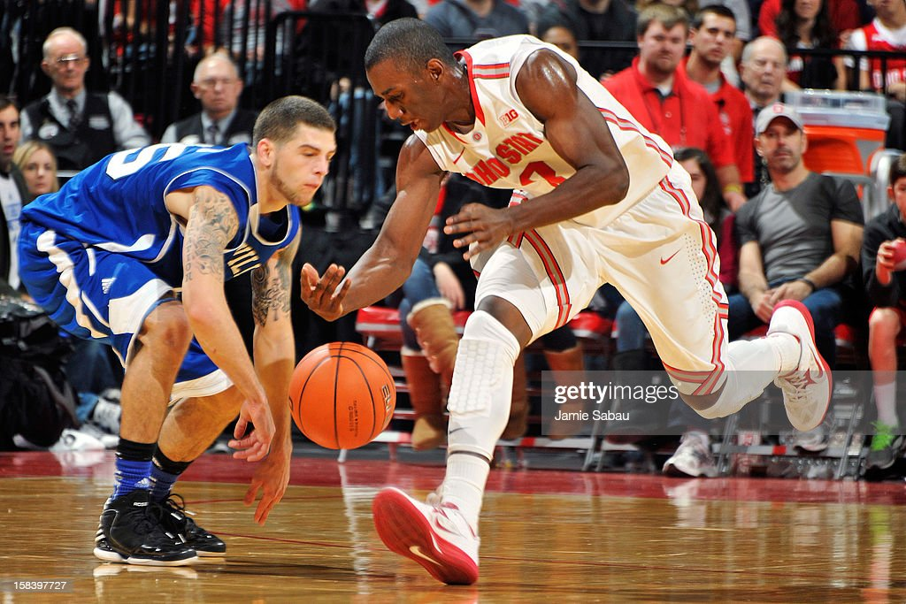 Shannon Scott #3 of the Ohio State Buckeyes steals the ball away from Trent Meyer #55 of the UNC Asheville Bulldogs in the second half on December 15, 2012 at Value City Arena in Columbus, Ohio. Ohio State defeated UNC Asheville 90-72.