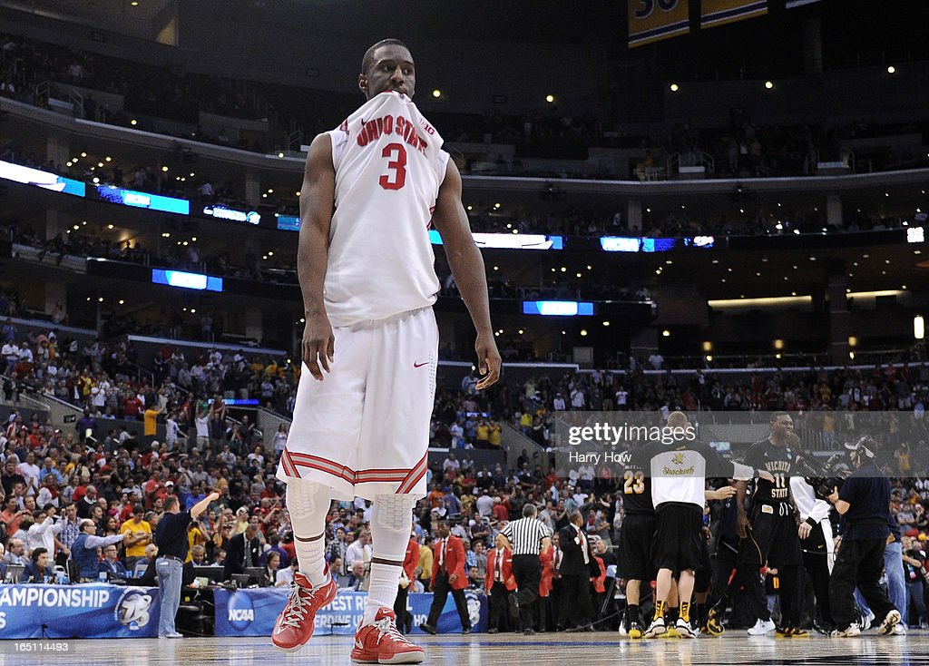 Shannon Scott #3 of the Ohio State Buckeyes walks off the court after losing to the Wichita State Shockers 70-66 during the West Regional Final of the 2013 NCAA Men's Basketball Tournament at Staples Center on March 30, 2013 in Los Angeles, California.