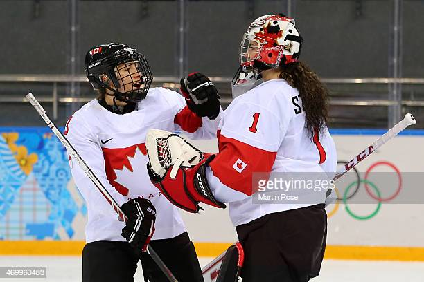 Shannon Szabados and Jocelyne Larocque of Canada celebrate after winning the game during the Women's Ice Hockey Playoffs Semifinal game 31 against...