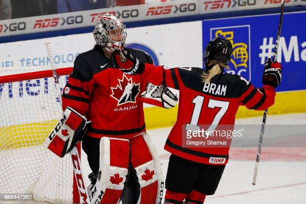 Shannon Szabados of Canada celebrates a 40 victory over Finland with Bailey Bram during a semifinal game at the 2017 IIHF Womans World Championships...