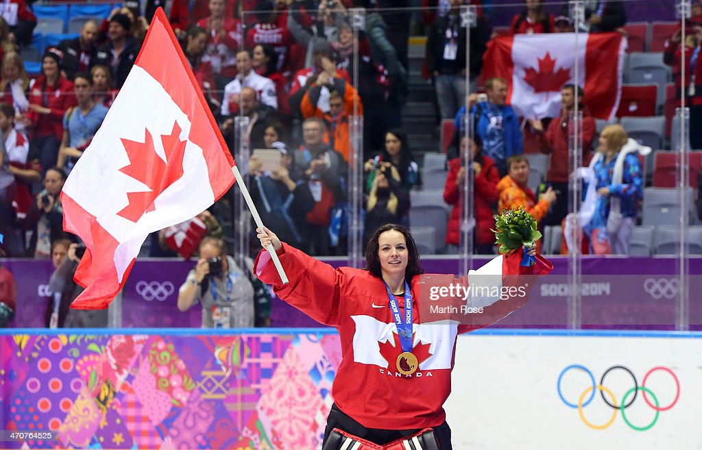 Shannon Szabados #1 of Canada celebrates during the flower ceremony after defeating the United States 3-2 in overtime during the Ice Hockey Women's Gold Medal Game on day 13 of the Sochi 2014 Winter Olympics at Bolshoy Ice Dome on February 20, 2014 in Sochi, Russia.