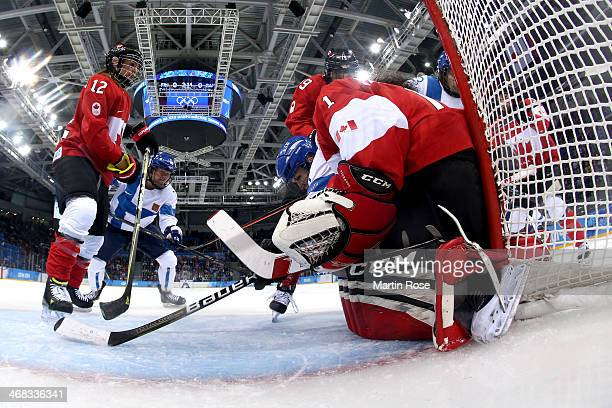 Shannon Szabados of Canada makes a save against Finland during the Women's Ice Hockey Preliminary Round Group A game on day three of the Sochi 2014...