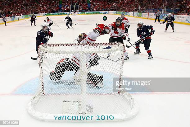 Shannon Szabados of Canada makes a save by tipping the puck over the net during the ice hockey women's gold medal game between Canada and USA on day...