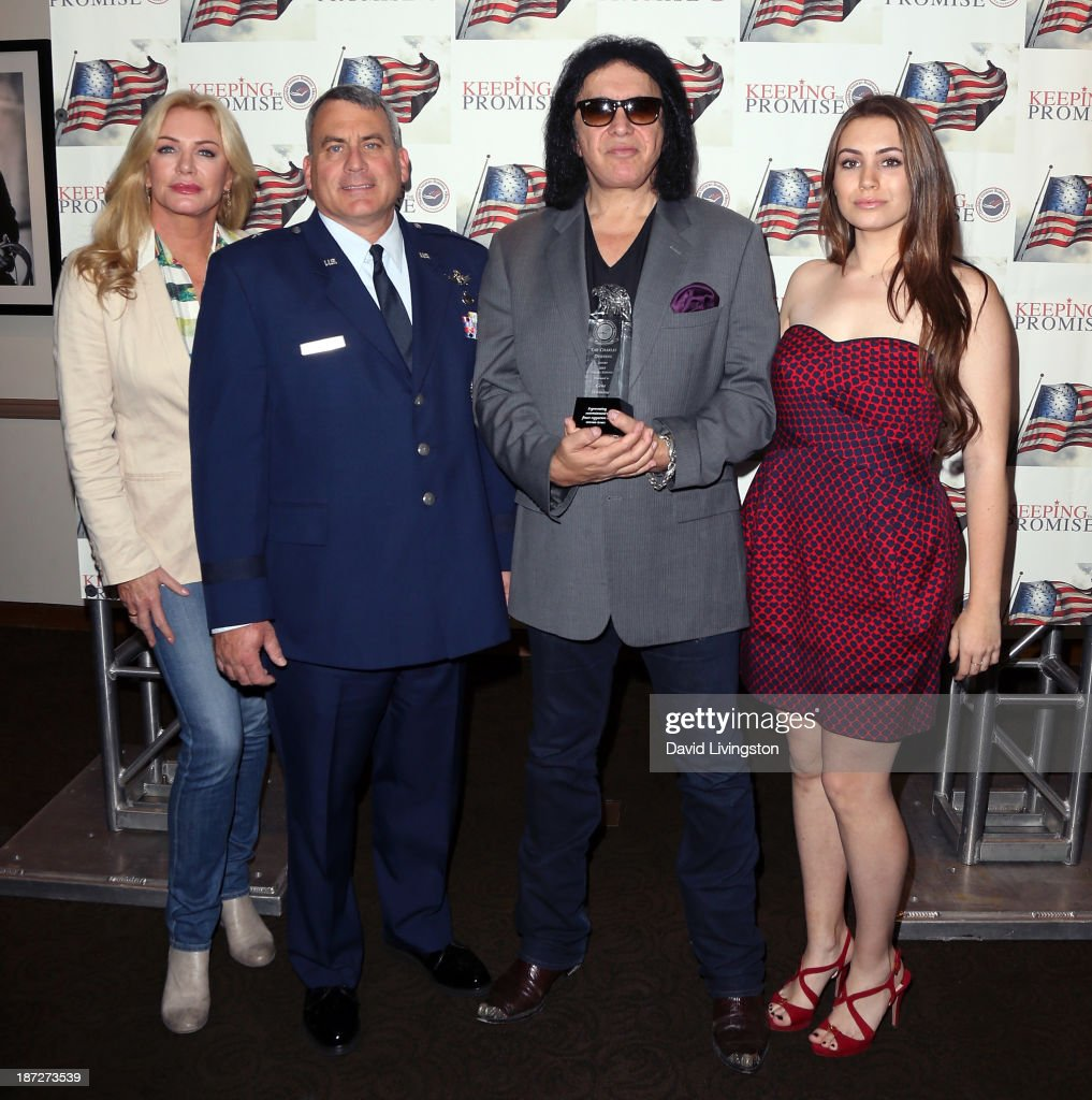 <a gi-track='captionPersonalityLinkClicked' href=/galleries/search?phrase=Shannon+Tweed&family=editorial&specificpeople=226528 ng-click='$event.stopPropagation()'>Shannon Tweed</a>, Brig. Gen. David O'Brien, recording artist <a gi-track='captionPersonalityLinkClicked' href=/galleries/search?phrase=Gene+Simmons&family=editorial&specificpeople=138593 ng-click='$event.stopPropagation()'>Gene Simmons</a> and <a gi-track='captionPersonalityLinkClicked' href=/galleries/search?phrase=Sophie+Simmons&family=editorial&specificpeople=650233 ng-click='$event.stopPropagation()'>Sophie Simmons</a> attend <a gi-track='captionPersonalityLinkClicked' href=/galleries/search?phrase=Gene+Simmons&family=editorial&specificpeople=138593 ng-click='$event.stopPropagation()'>Gene Simmons</a> being honored with the Durning Patriotism Award at the Salute to Veterans event hosted by the California Disabled Veterans Business Alliance at Paramount Studios on November 7, 2013 in Hollywood, California.