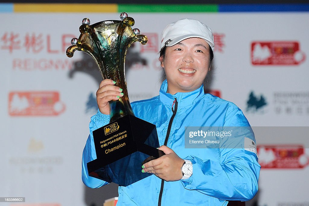 <a gi-track='captionPersonalityLinkClicked' href=/galleries/search?phrase=Shanshan+Feng&family=editorial&specificpeople=4682908 ng-click='$event.stopPropagation()'>Shanshan Feng</a> holds her trophy during the closing ceremony of the Reignwood LPGA Classic at Pine Valley Golf Club on October 6, 2013 in Beijing, China.