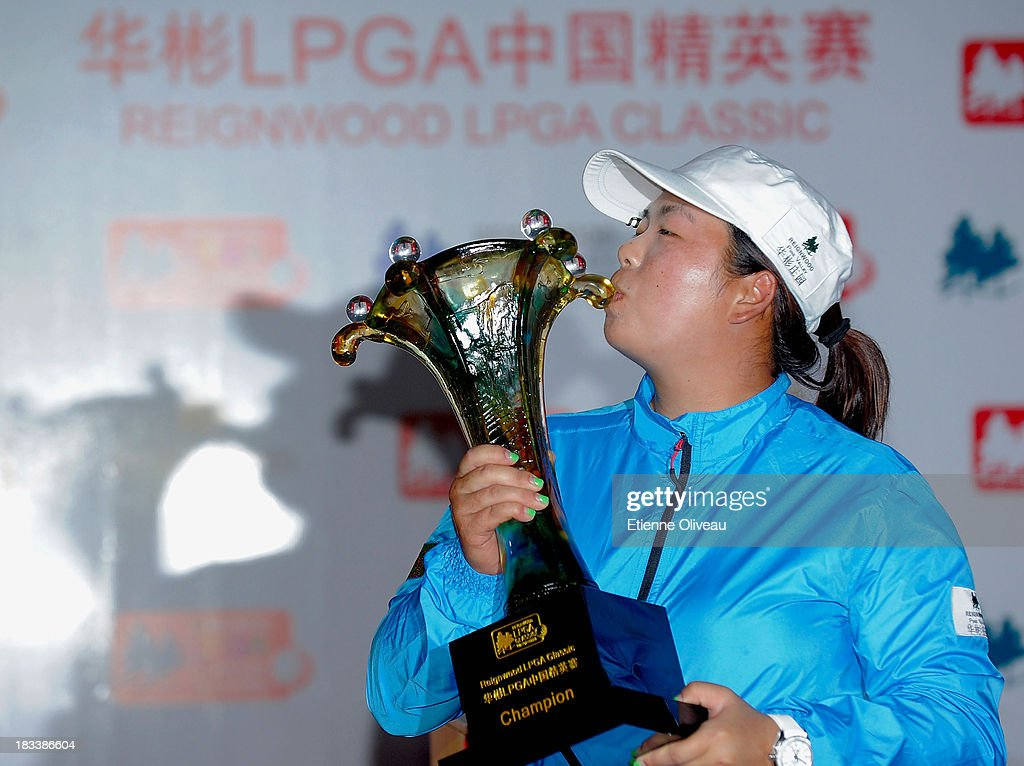 <a gi-track='captionPersonalityLinkClicked' href=/galleries/search?phrase=Shanshan+Feng&family=editorial&specificpeople=4682908 ng-click='$event.stopPropagation()'>Shanshan Feng</a> kisses her trophy during the closing ceremony of the Reignwood LPGA Classic at Pine Valley Golf Club on October 6, 2013 in Beijing, China.