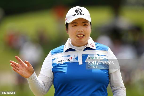 Shanshan Feng of China acknowledge the gallery on the 18th green during the final round of the Volvik Championship held at Travis Pointe Country Club...