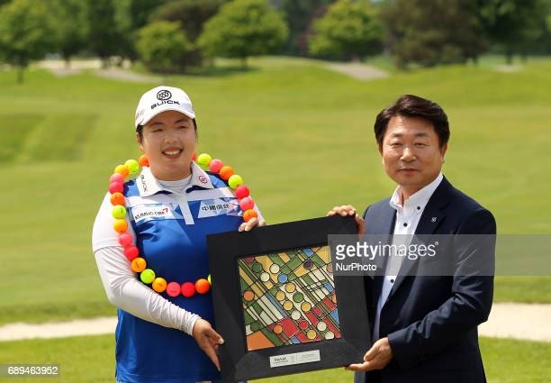 Shanshan Feng of China and Kyung Ahn Moon Chairman of Volvik INC pose for a photo after winning the Volvik Championship at Travis Pointe Country Club...
