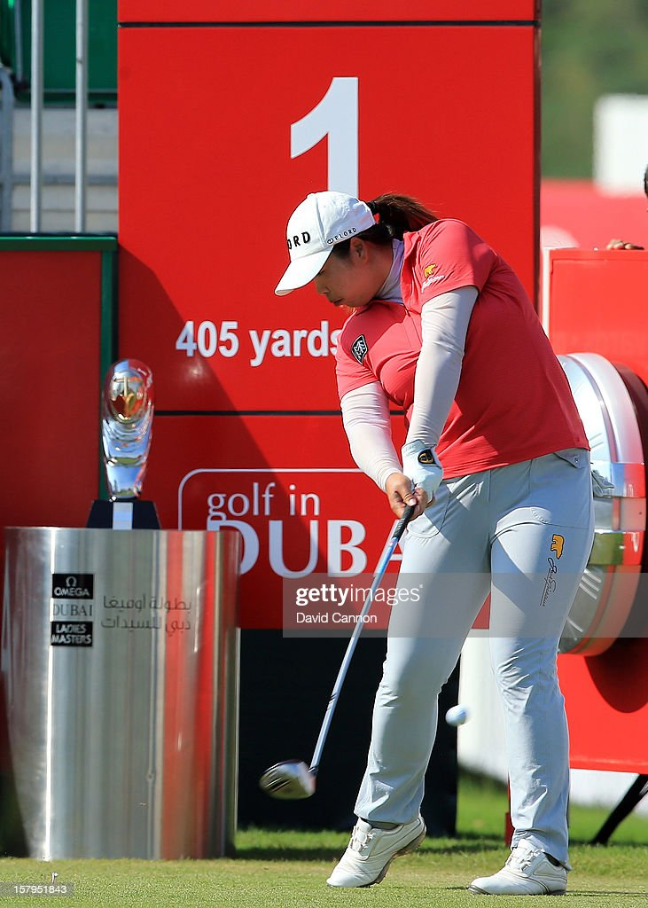 Shanshan Feng of China drives from the first tee during the final round of the 2012 Omega Dubai Ladies Masters on the Majilis Course at the Emirates Golf Club on December 8, 2012 in Dubai, United Arab Emirates.