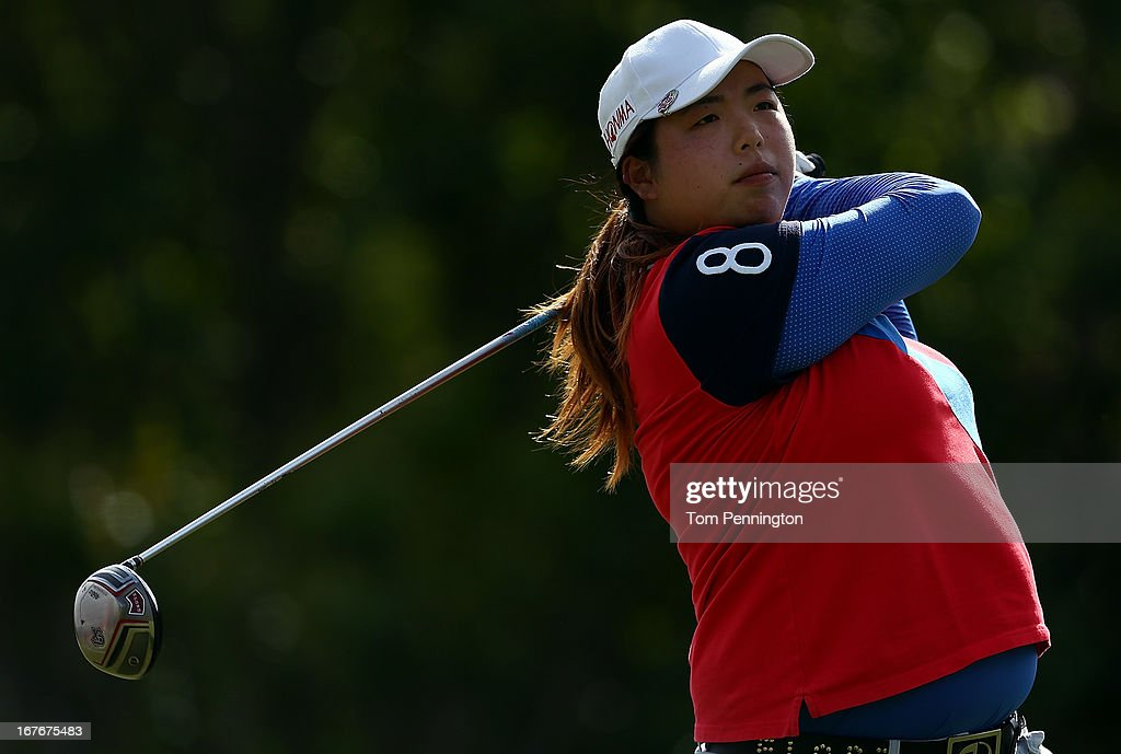 Shanshan Feng of China hits a shot during the third round of the 2013 North Texas LPGA Shootout at the Las Colinas Country Club on April 27, 2013 in Irving, Texas.
