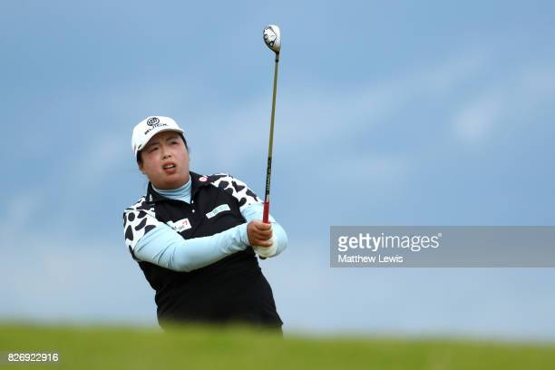 Shanshan Feng of China hits her second shot on the 4th hole during the final round of the Ricoh Women's British Open at Kingsbarns Golf Links on...