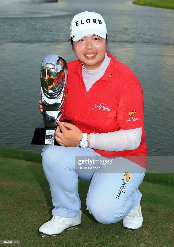 Shanshan Feng of China holds the Dubai Ladies Masters trophy after the final round of the 2012 Omega Dubai Ladies Masters on the Majilis Course at the Emirates Golf Club on December 8, 2012 in Dubai, United Arab Emirates.
