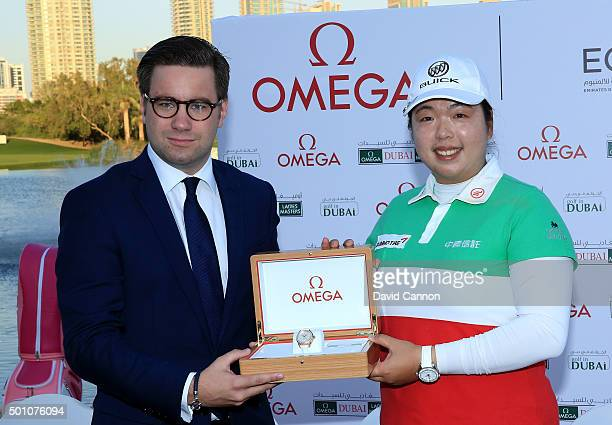Shanshan Feng of China is presented with her winners watch by Henri Burrus the Area Sales Manager Omega at the presentation ceremony after the final...