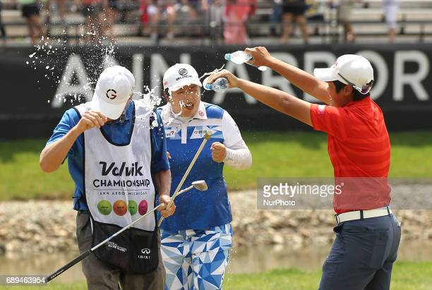 Shanshan Feng of China is showered with water by Haru Nomura of Japan after winning the Volvik Championship during the final round of the Volvik...