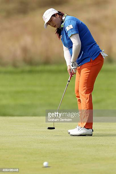 Shanshan Feng of China makes a putt during day one of the 2014 Reignwood LPGA Classic at Reignwood Pine Valley Golf Club on October 2 2014 in Beijing...