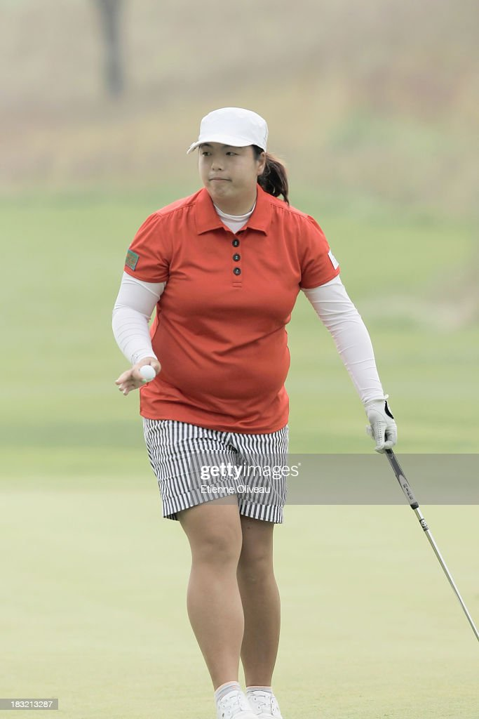 <a gi-track='captionPersonalityLinkClicked' href=/galleries/search?phrase=Shanshan+Feng&family=editorial&specificpeople=4682908 ng-click='$event.stopPropagation()'>Shanshan Feng</a> of China picks up her ball and waves to the audience during the final round of the Reignwood LPGA Classic at Pine Valley Golf Club on October 6, 2013 in Beijing, China.