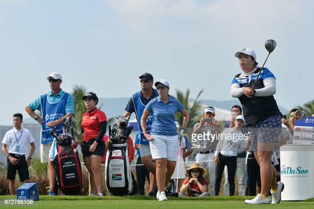 Shanshan Feng of China plays a shot on the 16th hole during the final round of the Blue Bay LPGA at Jian Lake Blue Bay golf course on November 11...